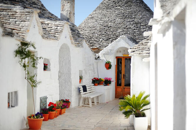 <b>Alberobello</b><br>   <br>   The town of Trulli, since 1996 declared UNESCO World Heritage-listed site, is a  place like no other for the peculiarity of its architectural styles, named  trulli, consisting of white-colored dry-stone buildings with conical dark grey  roofs
