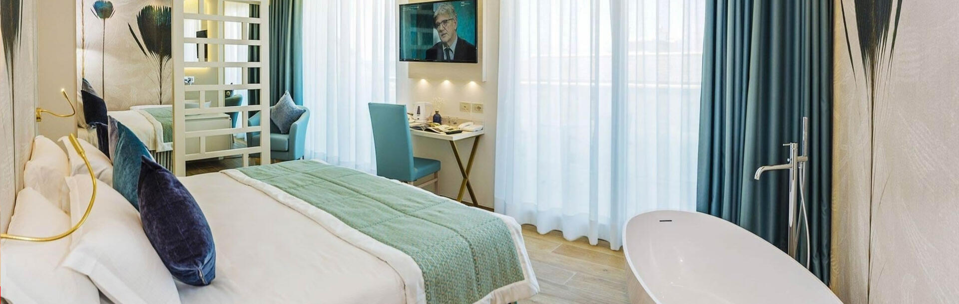 hotel-montecarlo de deluxe-living-suite-aparthotel-bibione 014